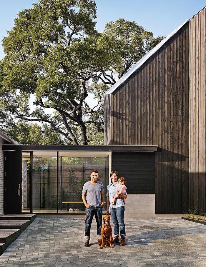 Exterior, Wood Siding Material, and House Building Type Doubling the footprint of their home and adding a pool could have placed Shah and Suttles on the wrong side of the city of Austin's strict impervious cover rules, which set square-footage limits and are intended to protect local water quality. So they installed high-tech Eco-Priora pavestones in their driveway to help capture rainwater runoff. It's not quite as fancy as the underground storage tank they sought at their first collaboration with Alterstudio, but the strategy allowed them to go green and stick to their design.  Photo 11 of 12 in 1920s Bungalow Plus Modern Addition Equals Perfect Austin Home