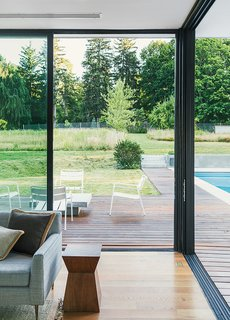 Cute Couple Alert: Modern Prefab Poolhouse Addition to a 1920s Sears Kit House - Photo 7 of 11 - The aluminum sliding glass door system, manufactured by Solar Innovations, comprises five seamless panels that meet at the corner.