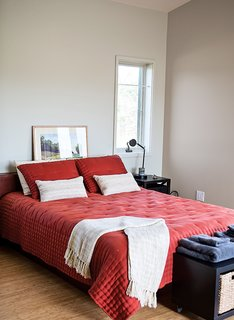 The master bedroom is furnished with an Asher platform bed from the Century House.