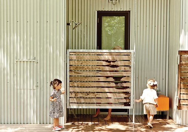 """An outdoor shower tucked behind a screen off the master bedroom neutralizes this threat. """"We thought it sounded great for muddy kids to run up and shower off there,"""" Coco says.  Photo 6 of 11 in Modular Compound is the Ultimate Retreat for Three Generations"""