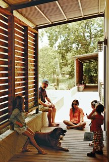Modular Compound is the Ultimate Retreat for Three Generations - Photo 9 of 11 - Red-cedar screens shade the modules' western walls, and part of the walkway that connects them, from the Texas sun.
