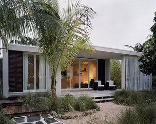 10 Coastal Prefabs That Bring Modular Housing to the Beach - Photo 10 of 10 - This 685-square-foot prefab shelter by Dutch firm Cubicco was built to withstand Category 5 hurricanes, extreme heat and cold, 10-foot snow loads, and earthquakes. Cubicco's prefab houses are built with laminated veneer lumber, an engineered material that uses up to 90 percent of a tree—compared to typical wood timbers that use only 60 to 70 percent. Modules can be disassembled if the owners relocate.
