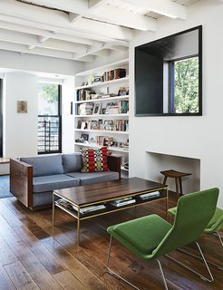 Brooklyn Home Keeps its Historic Bones While Getting a Much Needed Interior Update - Photo 4 of 13 - A vintage sofa purchased from Open Air Modern mixes with Low Pad chairs, by Jasper Morrison for Vitra, in the living room, which features a window inspired by Marcel Breuer's Whitney Museum of American Art.