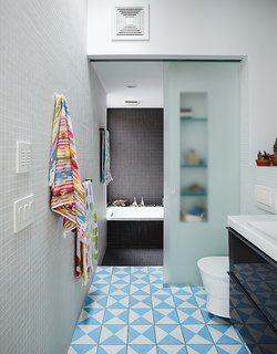 The second-floor bathroom includes a washroom that can be closed off from the bathing area with a sliding glass door. Bauer and Magid can supervise the kids' baths or use it as a steam room.