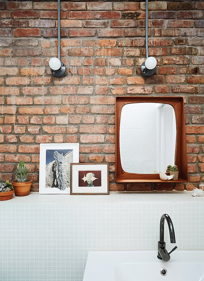 Bath Room, Wall Lighting, Wall Mount Sink, and Mosaic Tile Wall A Godmorgon vanity from Ikea is paired with white field tiles from Mineral Tiles.  Photo 4 of 11 in 10 Charming Brick Interiors