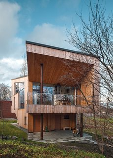 The exterior is clad in Siberian larch, which doesn't require paint and will develop a gray patina.