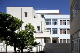 Tel Aviv is home to one of the largest neighborhoods of Bauhaus architecture, known as the White City. This building, The Norman Hotel in Tel Aviv, was originally designed as two separate apartment buildings in 1925: one half features Renaissance and oriental influences, while the other is a clean-lined, modernist structure reflective of Bauhaus design.