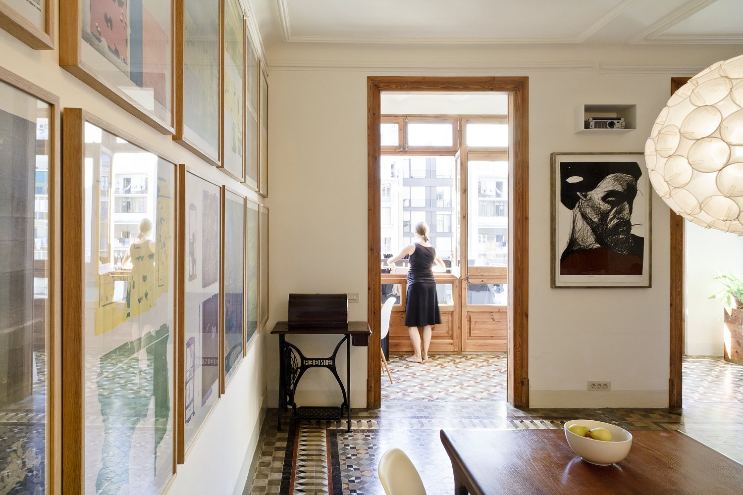 Though the renovation was significant, you wouldn't necessarily know it, as the new materials blend well with the old. The transitions between spaces, such as that from the living room to an enclosed veranda, feel completely natural.  Photo 2 of 8 in Historic Details and Playful Modernism Meet in this Stunning Barcelona Flat