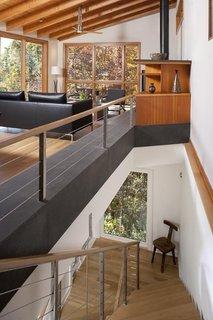 A Contemporary North Carolina Home Navigates a Tricky Site Atop a Ridge - Photo 8 of 10 -