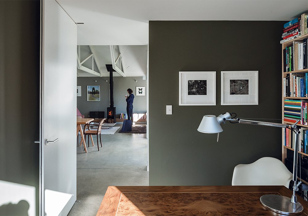 Office, Lamps, Chair, and Desk In the office, a Tolomeo desk lamp from Artemide rests on a desk that Stock designed and built in her university days. The Static shelving is by Lundia.  Photo 4 of 7 in A Dramatic Cutout Wall and Other Surprises Define This Playful House