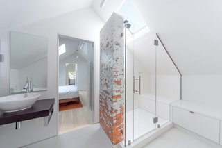 An attic in this Seattle home was transformed into a master bedroom with a beautiful ensuite bathroom. The homeowners worked with Boston-based company Artaic on the unique mosaic tiles for the shower.