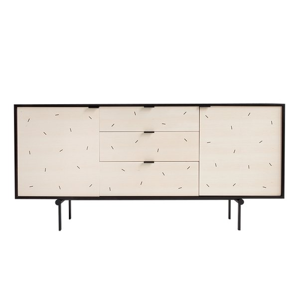 """We've had an eye on New York's Syrette Lew, known professionally as Moving Mountains, since she made our 2015 Young Guns roster of rising designers. On her profile, you'll find plain but playful furniture, like her Confetti credenza. """"I was sick of all the rustic, reclaimed wood in Brooklyn, so when my boyfriend moved in, I decided to make pieces that we'd actually want to live with,"""" she says."""