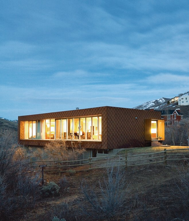 Exterior, House Building Type, Cabin Building Type, Flat RoofLine, and Wood Siding Material In the land of large mountain lodge wannabes, two California natives tuck Utah's first LEED for Homes–rated house onto the side of Emigration Canyon. Photo by Dustin Aksland  Photo 90 of 101 in 101 Best Modern Cabins