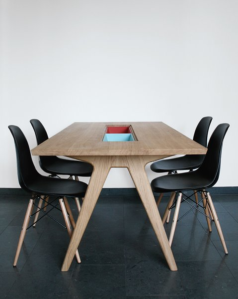 """Paired with Eames side chairs, her dining table includes two cases """"to either hide or show things,"""" she says.  Photo 12 of 14 in Modern Furniture Designer Continues Her Family Tradition"""