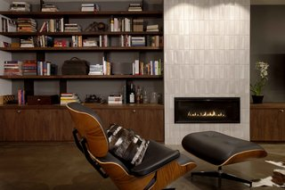This San Francisco home in the Theatre Lofts building, built in 1926 as a movie palace, was given a sophisticated upgrade by LOCZIdesign for a couple. A new study makes it possible for the husband to read and work late into the night, while the wife sleeps upstairs. The modern fireplace is clad in ceramic tile with a subtle textural pattern.