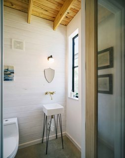 7 Stylish Bathroom Sinks That Can Fit in Even the Tiniest of Spaces - Photo 2 of 8 - Although the sink was special ordered from Home Depot, Pavonetti designed the base to give the basin a snug fit. He built the base out of a steel rod and painted it with black shoe polish.
