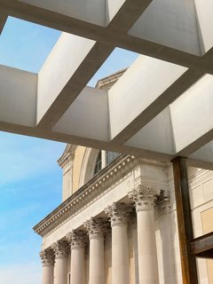 Beaux Meets New - Photo 5 of 9 - A view of the interior's coffered ceiling stretching outside. Image courtesy of the Saint Louis Art Museum.