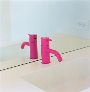 Eric Grunbaum added a hot pink powder-coated faucet by Vola for the downstairs bath in his Venice Beach home. Photo by Ye Rin Mok.