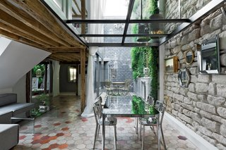 """""""At Rue Vignon I wanted to distort reality in order to create intriguing visions,"""" explains architect Michael Herrman, who renovated an 18th-century structure in Paris for himself and his family. He was inspired by an apartment created in the 1930s by Le Corbusier. Photo by Filippo Bamberghi."""
