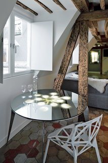 One of Herrman's designs, the Enlightened Table, appears to reflect a lamp's light, although nothing hangs overhead.