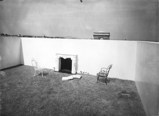 Le Corbusier's outdoor garden with a fireplace and the grass lawn 'carpeting.'