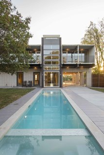 A 40 foot by 10 foot pool is designed to echo the house's tower with an almost reflection-like alignment.