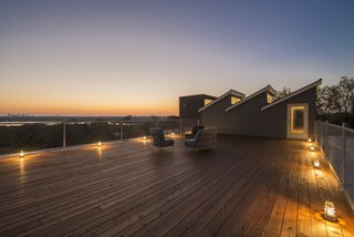 A 1400-square-foot roof deck offers panoramic views, overlooking White Rock Lake with one of the highest elevations in the city.