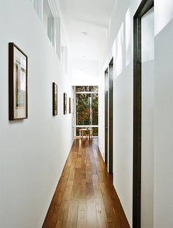 The interiors are painted in Sherwin-Williams Extra White Flat; flooring is five-inch walnut plank. A bentwood table and chairs are from ECR4Kids.