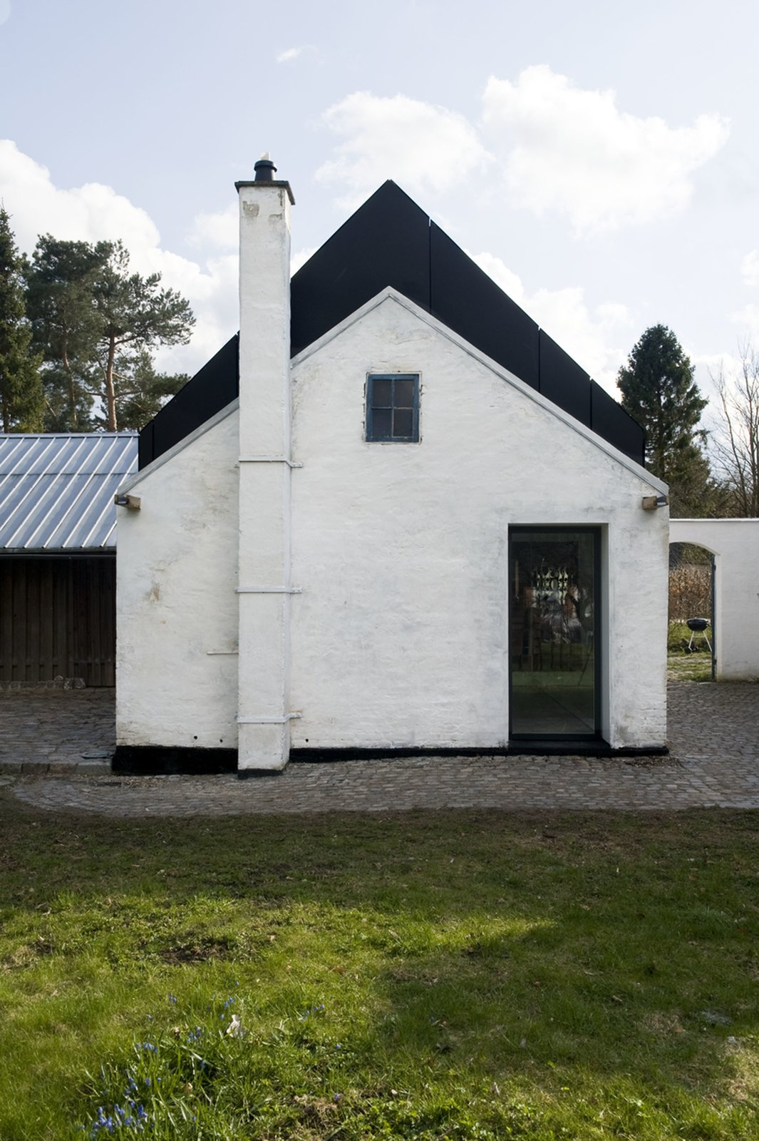 The family's country estate is the oldest home in Farum and sits on the outskirts of the town. Before the Asmussons bought the house, it was owned by an elderly woman with a passion for plastic bags, who called her home 'Posehuset,' or bag house. Today, although the name remains the same, the studio is host to a diverse range of artistic activities and music productions.  Photo 7 of 9 in 8 Barn Houses For Modern Living from Danish Farmhouse Turned Contemporary Art Studio