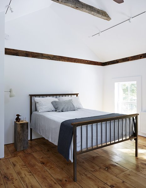 All of the home's wide-plank floors were reclaimed from the original farmhouse during the demolition process.  Photo 13 of 22 in A Mind-Bending Renovation Brings a Bold, Modern Addition to an Old Farmhouse