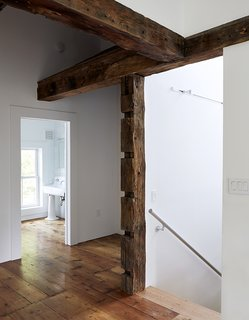 "In the existing house, the wood beams were hidden under sheetrock and wallpaper. ""I exposed them all, but I didn't let that dictate where the new walls would go,"" Givone says. ""I let the beams fall where they may."""