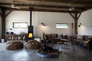 """Most of the home's furniture was purchased at Restoration Hardware, Circa Modern, or antique shops. """"We both love the midcentury designs that we grew up with,"""" Bronee says. """"We wanted furniture that was authentic to us and our personal styles while also fitting into a Catskills hideaway barn."""""""