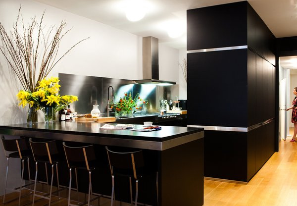 Arclinea's black cabinets with stainless-steel trim outfit the Manhattan kitchen of Dana Dramov.
