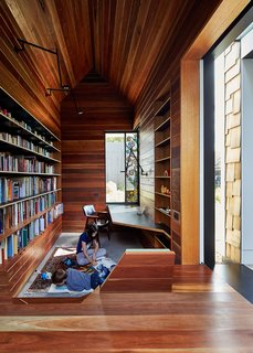 High ceilings and natural light prevent this small library that's clad in reclaimed wood from feeling overwhelming or oppressive. The wood, a salvaged spotted gum, is a durable wood that's native to Australia and is often used in structural, exterior, and interior applications. It ranges from a deep, reddish tone to a much lighter, almost yellow-white color. The library was part of a renovation of a family residence by Melbourne-based architects Andrew Maynard and Mark Austin of Andrew Maynard Architects.