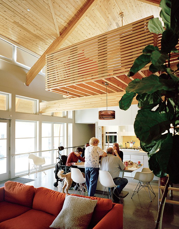 Dining Room, Chair, Table, Concrete Floor, and Pendant Lighting Inside, cedar beams add warmth while polished concrete floors provide easy passage for Matthew's wheelchair. Other universal-design features include drop-down mechanisms for the kitchen counters and cooktop from Freedom Lift Systems.  Photo 2 of 8 in This Impressively Accessible Home Has a Tower That Can Be Reached by Wheelchair