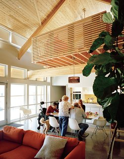 Inside, cedar beams add warmth while polished concrete floors provide easy passage for Matthew's wheelchair. Other universal-design features include drop-down mechanisms for the kitchen counters and cooktop from Freedom Lift Systems.