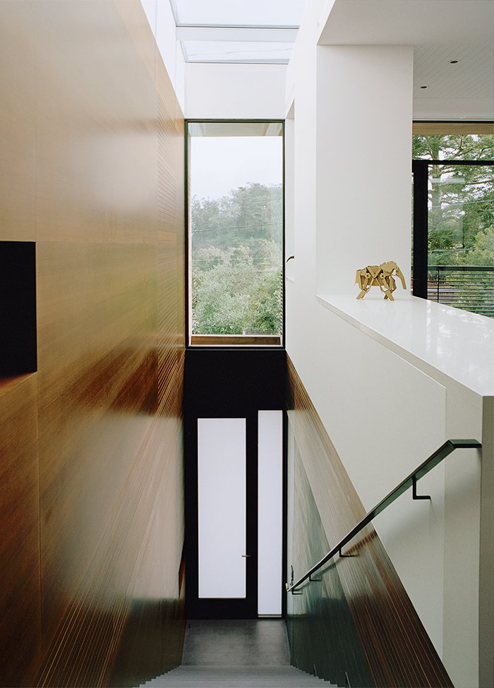 Staircase and Metal Railing At the top of the stairs, a panorama of the Glen Park neighborhood is revealed.  Photo 4 of 13 in A Meticulous Renovation Turns a Run-Down House Into a Storage-Smart Gem