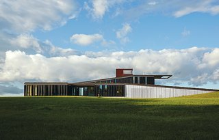 A Prairie Escape Embraces the Landscape with a Green Roof - Photo 9 of 10 -