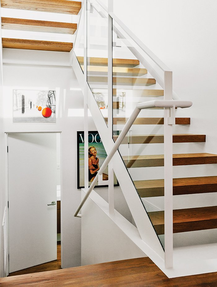 "Staircase and Metal Railing ""The treads are open because we wanted to have as much light come down as possible,"" says Dimster.  Photo 7 of 15 in A Midcentury Home Enjoys Views from Every Angle"