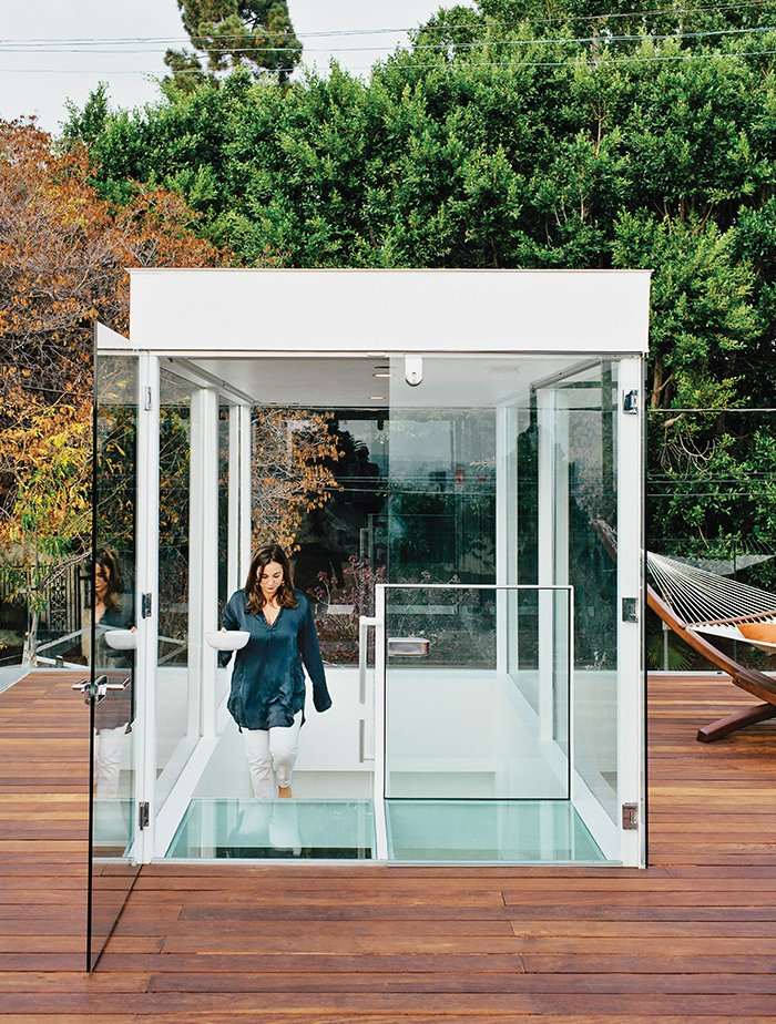 """Outdoor, Rooftop, and Large Pools, Tubs, Shower Dimster added new, two-story-tall beams to support the weight of the glass box topping the stair. """"We were missing a grand outdoor space—that's where the roof deck comes into play,"""" Dimster says.  Photo 8 of 15 in A Midcentury Home Enjoys Views from Every Angle"""