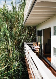 Marjorie takes to a Brumby rocking chair on the deck off the bedroom, which is privatized by a forest of bamboo.