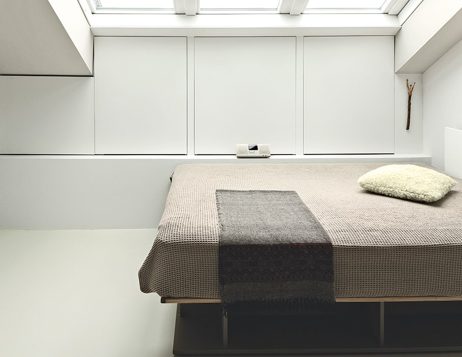 Bedroom and Bed The bed, also by Hynam, is on casters, allowing ten Hompel to move it to gaze at the stars.  Photo 9 of 10 in This Is How You Can Live Large in a Small Space