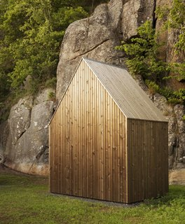 For their Micro Cluster Cabin, Norwegian architecture firm Reiulf Ramstad Arkitekter designed a shed that stored firewood and gardening supplies, and that unmistakably was connected with the main house through its steeply gabled roof and aged pine cladding.