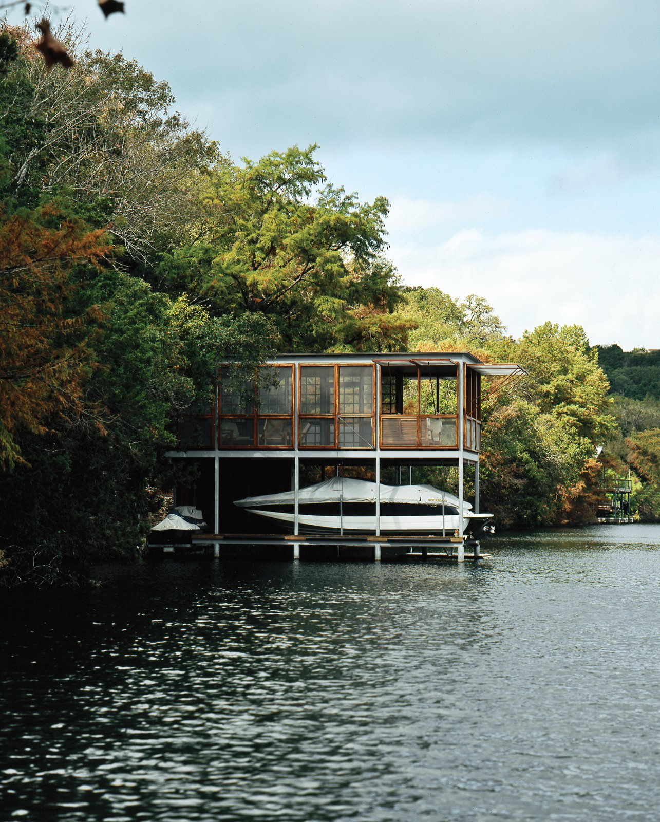 "Exterior, House Building Type, Boathouse Building Type, and Flat RoofLine ""We wanted to make a delicate mark on the landscape, without blending into it outright,"" says Andersson.  Photo 1 of 1 in A Prefab Texas Boathouse Gets Delivered to Lake Austin"