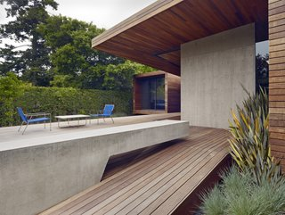 A spacious deck was created as part of the addition. A cantilevered concrete bench stretches out to the rear garden and complements the adjacent concrete wall.