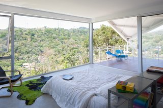 Floor-to-ceiling glass walls give the residents the illusion of living outdoors.