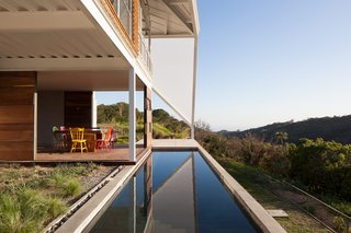 The back patio overlooks a swath of forest.