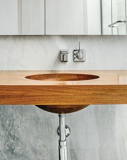 Breakfast Woodworks created the custom teak vanity in the master bathroom.