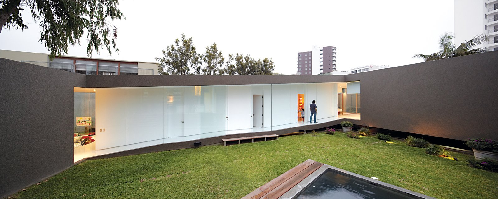 Exterior, House Building Type, and Concrete Siding Material At once part of the city and protected from it, the house benefits from plenty of open space and light and creates its own courtyard enclosure.  Photo 5 of 13 in A Modern Concrete Home in Peru