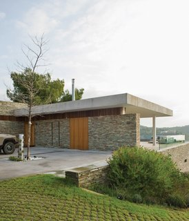 "In an effort to root the home to its location, the team elected to use dry-stacked slate quarried from a nearby island for much of the main structure. ""These walls are common in the Pelion area of Greece,"" says Achilleas."
